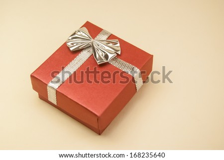 red gift box with ribbon and bow isolated on white - stock photo