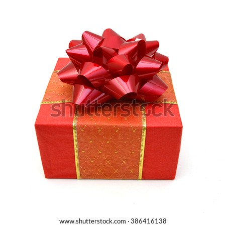 Red gift box with ribbon bow. Holiday present. Object isolated on white background.  - stock photo