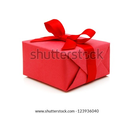 Red gift box with ribbon bow isolated on white background - stock photo