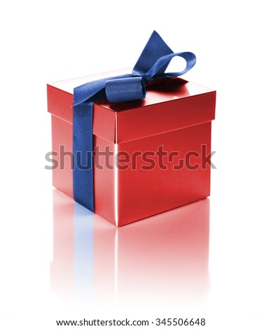 red gift box with ribbon isolated on white - stock photo
