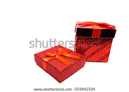 Red gift box with ribbon on white background / Selective focus
