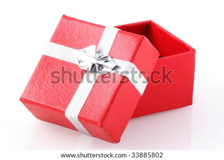 Red gift box with silver ribbon isolated on white. - stock photo