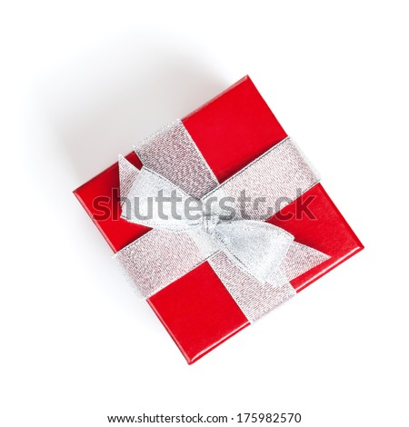Red gift box with silver ribbon. Isolated on white background. View from above - stock photo