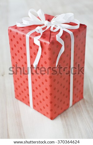 red gift box with white ribbon - stock photo