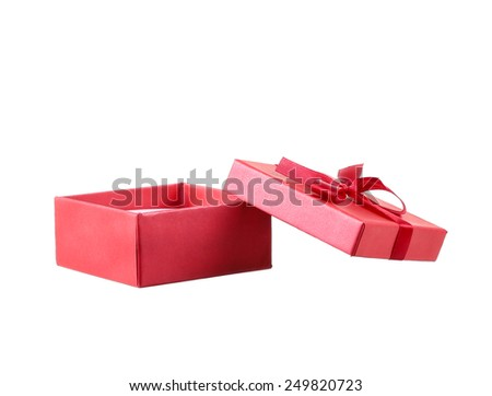 Red gift box with white ribbon isolated on red background. Clipping path included.