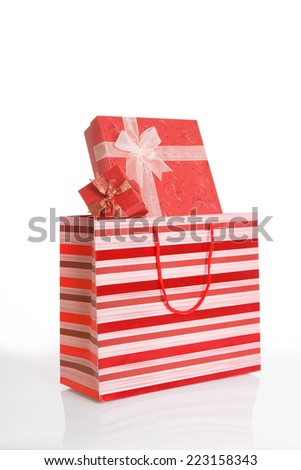 Red gift boxes  in red shopping bag on white background