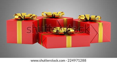 red gift boxes with golden ribbons isolated on gray background - stock photo