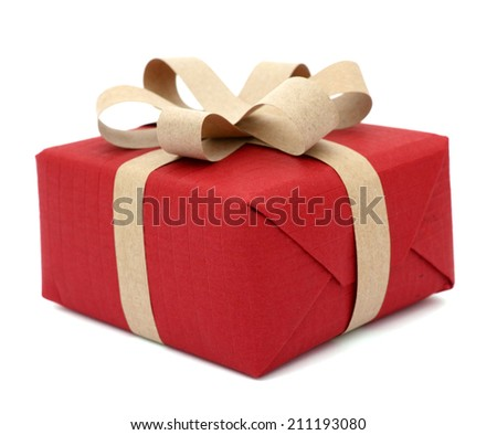 Red gift, by hand wrapped - stock photo