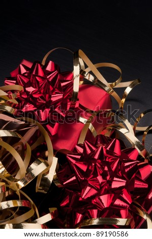 Red gift on a black background - stock photo
