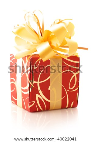 Red gift with gold bow isolated on white background.