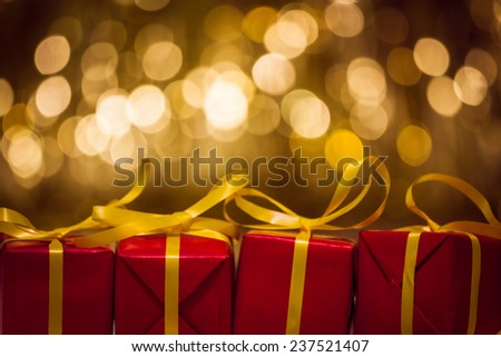 red gifts on gold background