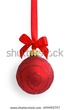 Red glass glitter Christmas bauble (decoration) with a shadow, hanging on a red satin ribbon with a bow, on white background