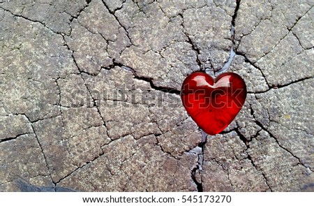 Red Glass Heart on Cracked Timber