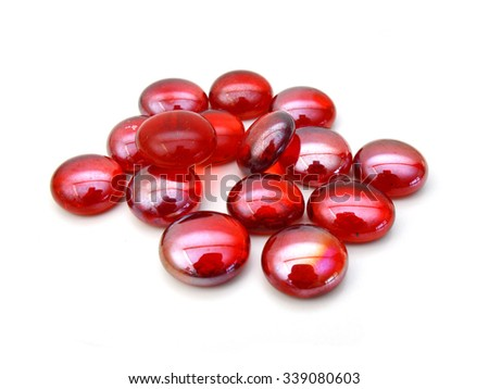 Red glass stones on white background.