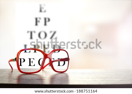 red glasses and dark desk with black text  - stock photo
