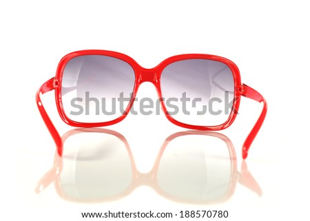 red glasses on white  - stock photo