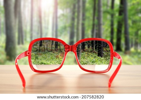 red glassses and forest  - stock photo