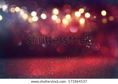 Red glitter vintage lights background. defocused