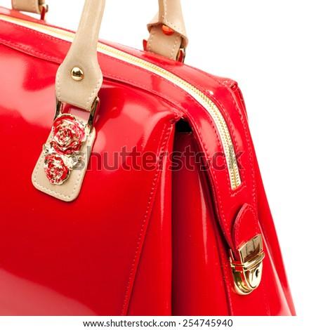 Red glossy female leather handbag isolated on white background.  - stock photo