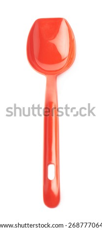 Red glossy plastic kitchen cooking scoop isolated over the white background - stock photo