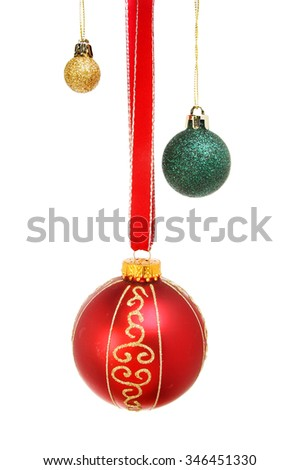 Red, gold and green Christmas glitter baubles isolated against white