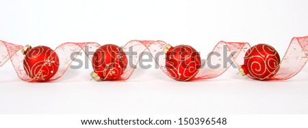 Red-golden baubles with the ribbon on the white background - stock photo