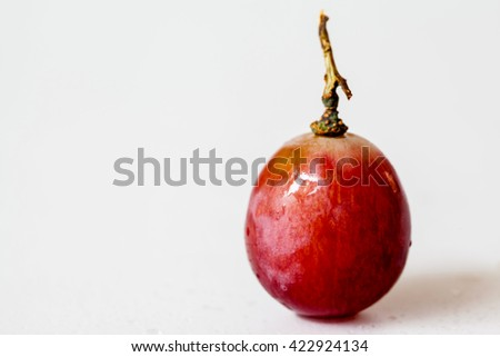 Red grape in a basket on white background