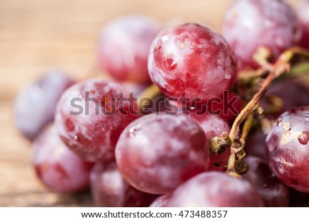 red grape on wooden background