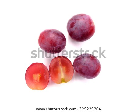 Red grape sliced in a half isolated on a white background. - stock photo
