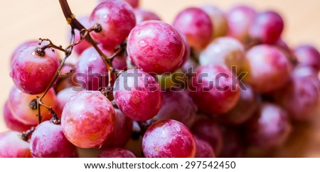 Red grape with water drops.