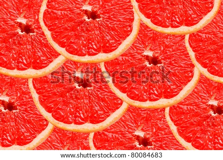red grapefruit  slices background