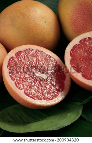 Red grapefruit, whole and halved