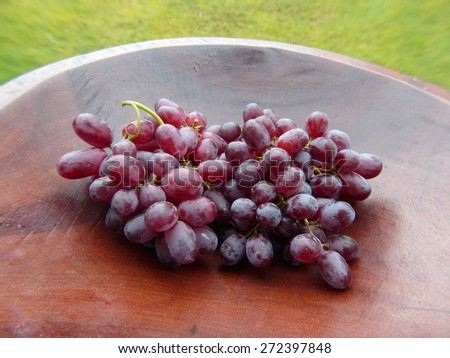 Red grapes. A grape is a fruiting berry of the deciduous woody vines of the botanical genus Vitis. - stock photo
