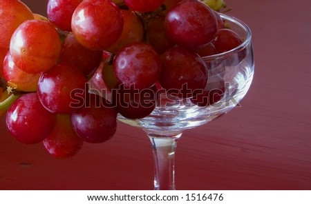 red grapes in stemmed glass