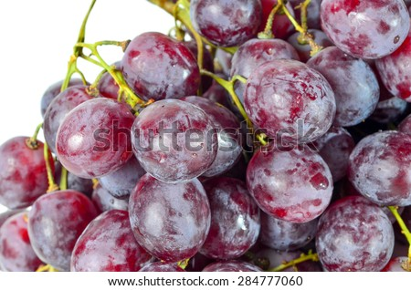 Red Grapes shoot over white background. Shallow depth of field, focus on front of the subject.
