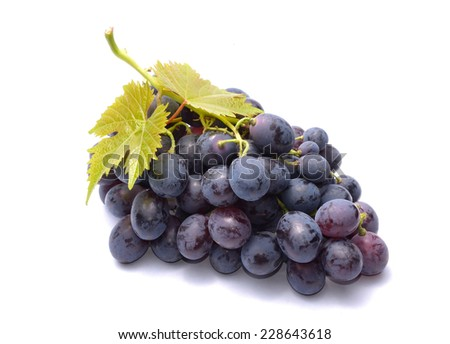 Red grapes with leaves isolated on white background - stock photo