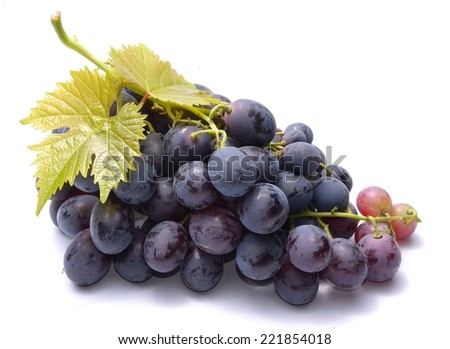 Red grapes with lleaveas isolated on white background - stock photo