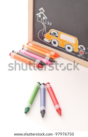 Red Green and Blue Crayons with Chalk Board - stock photo