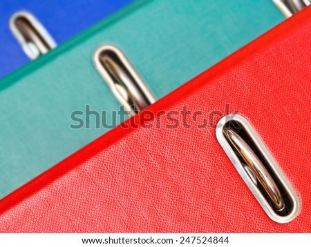 Red, green and blue ring binder closeup - stock photo