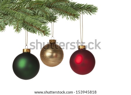 Red, green and gold baubles hanging on Christmas tree for holiday background. With copy space. - stock photo