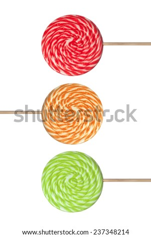 Red, green and orange lollipop isolated on white background  - stock photo