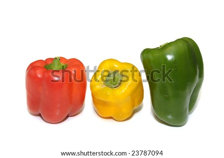 Red, green and yellow pepper isolated in white