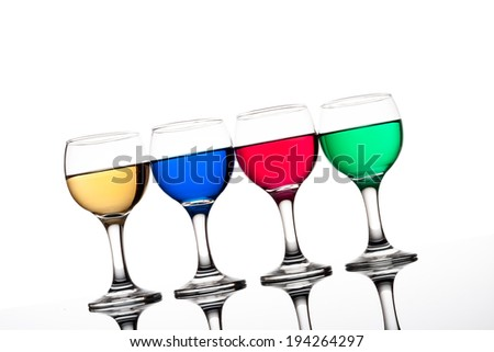 red, green, yellow and blue backlit drinks with reflection