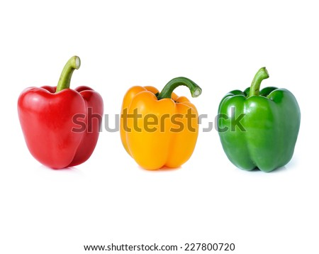 red green yellow pepper on white background - stock photo