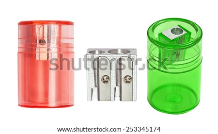 Red, grey and green sharpeners for pencils, isolated, on the white - stock photo
