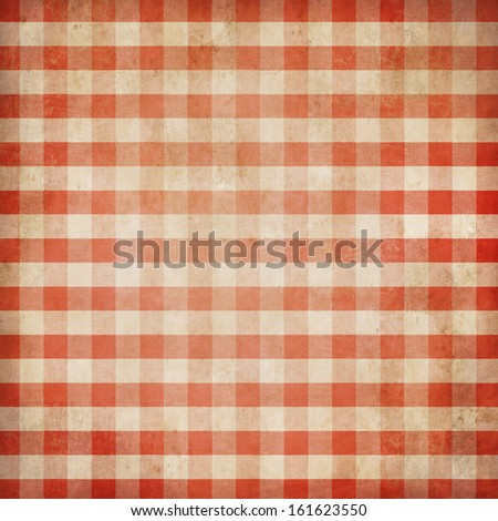Red grunge checked gingham picnic tablecloth background - stock photo
