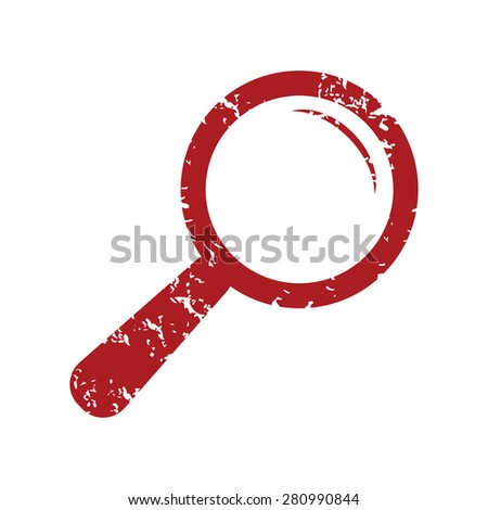 Red grunge magnifying glass logo on a white background