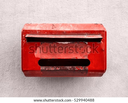 Red Grunge old Mail box vintage on white background wall cement texture.