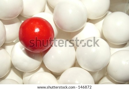 Red gumball in with gumball background - stock photo