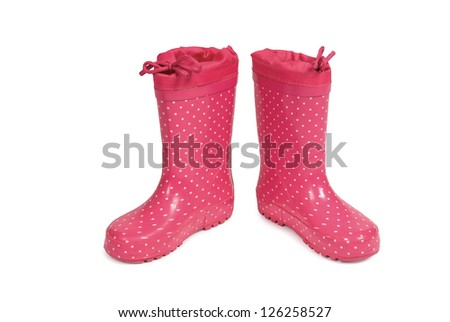 Red gumboots with spots on a white background. Clipping path included.